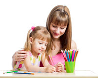 Mother and child girl pencil together Stock Photography