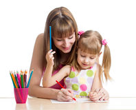Mother and child girl pencil together Stock Images