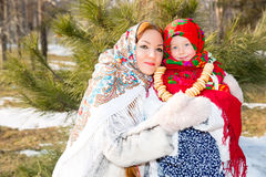 Mother and child girl in Russian pavloposadskie folk scarf Royalty Free Stock Photo