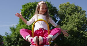 Mother with Child Girl on a See Saw Rocker on a Playground Smiling Playing on a Playground stock video footage
