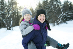 Mother and child girl on a winter in nature. A Mother and child girl on a winter in nature Royalty Free Stock Photos