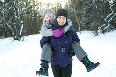 Mother and child girl on a winter in nature. A Mother and child girl on a winter in nature Stock Photography