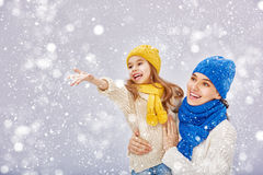 Mother and child girl on a winter walk. Happy family! Mother and child girl on a winter walk Stock Images