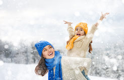 Mother and child girl on a winter walk. Happy family! Mother and child girl on a winter walk in nature Stock Photography