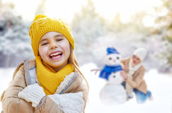 Mother and child girl on a winter walk stock photos