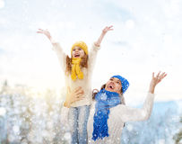 Mother and child girl on a winter walk. Happy family! Mother and child girl on a winter walk in nature Stock Photos