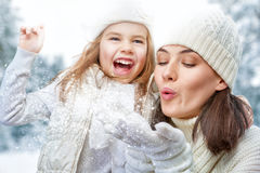 Mother and child girl on a winter walk. Happy family! Mother and child girl on a winter walk in nature Royalty Free Stock Photo