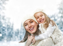 Mother and child girl on a winter walk. Happy family! Mother and child girl on a winter walk in nature Stock Photo