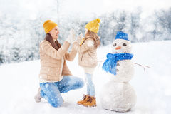 Mother and child girl on a winter walk. Happy family! Mother and child girl on a winter walk in nature Royalty Free Stock Images