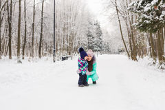 Mother and child girl on a winter walk in nature. Happy family Royalty Free Stock Images