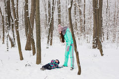 Mother and child girl on a winter walk in nature. Happy family Stock Photo