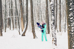 Mother and child girl on a winter walk in nature. Happy family Royalty Free Stock Image