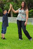 Mother and child giving high five royalty free stock photography