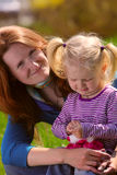 Mother with child on a grass Stock Photography