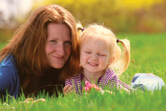 Mother with child on a grass Stock Photos