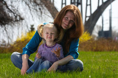 Mother with child on a grass Royalty Free Stock Photography