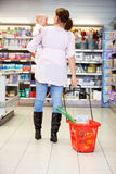 Mother with Child in Grocery Store Stock Photography