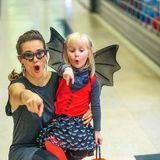 Mother and child on Halloween at mall pointing at something Stock Photos