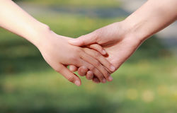 Mother and child hand in hand Royalty Free Stock Photo