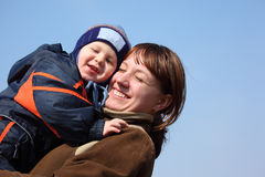 Mother with child on hands on sky background. Mother with child on hands on spring sky background Stock Photos