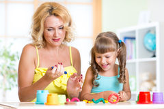 Mother and child have fun with colorful play clay Royalty Free Stock Photography