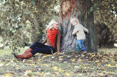 Mother and child having fun in autumn Royalty Free Stock Photo