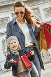 Mother and child having fun time near Arc de Triomphe in Paris. Stylish autumn in Paris. smiling young mother and child with shopping bags near Arc de Triomphe Stock Photography