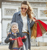 Mother and child having fun time near Arc de Triomphe in Paris Royalty Free Stock Images