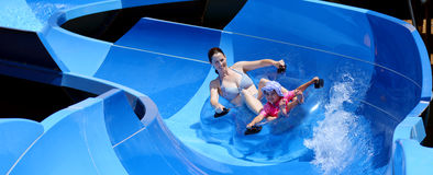 Mother and child having fun in water park stock photos