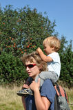 Mother with child on shoulders Stock Image