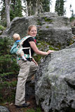 Mother and child hiking. On mountain terrain Stock Image