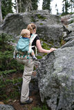 Mother and child hiking. On mountain terrain Stock Images