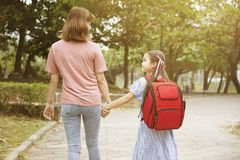 Mother and child holding hands going to school royalty free stock photography
