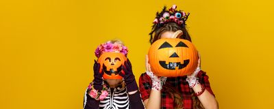 Mother and child holding jack-o-lantern pumpkins Stock Images