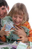 Mother and child holds a money. A happy mother with a child holds a money Stock Photography