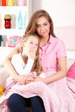 Mother with child at home Stock Images
