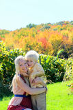 Mother and Child Hugging at Autumn Apple Orchard Stock Photos