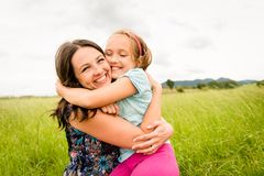 Mother and child hugging Royalty Free Stock Images