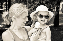 Mother,child and icecream. Mother and child eating icecream in the park Stock Photography