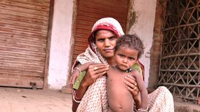Mother with child in India. An Indian village mother holding her child Royalty Free Stock Images