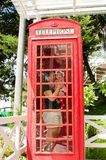 Mother and child inside vintage phone booth Royalty Free Stock Images