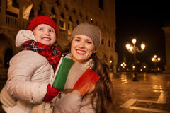 Mother and child with Italian flag on Piazza San Marco in Venice Stock Images