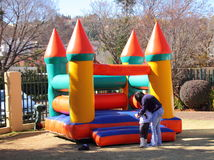 Mother child and a jumping castle. A mother her child at a jumping castle at a kid`s party Royalty Free Stock Photo