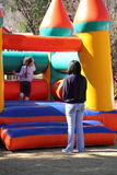 Mother child and a jumping castle. A mother her child at a jumping castle at a kid`s party Stock Photos