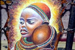 Mother and child painting. Mother and child by Kenyan painter on leather in Mombasa Kenya Royalty Free Stock Photography