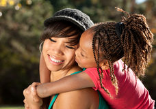 Mother and Child, Kiss. African American mother and child having fun spending time together in a park Stock Photos