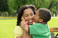Mother and Child Kiss. African American mother and son, spending time together Stock Image