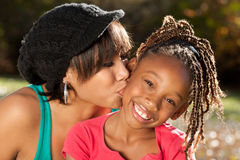 Mother and Child, Kiss, Love. African American mother and child having fun spending time together in a park Royalty Free Stock Photo