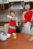 Mother and child in the kitchen Stock Photos