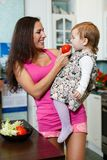 Mother with child in the kitchen. Royalty Free Stock Image
